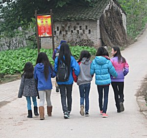 Walking together in a village.