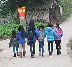 Walking together in a village.