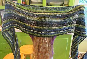 A new wrap I knit. Wide wingspan with silk. The white lines are made with yarn that belonged to my grandmother.